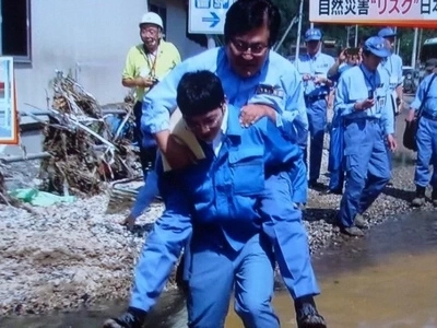 This Japanese minister was taking piggyback rides on the site of a deadly storm