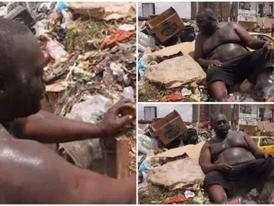 Overweight man pictured rummaging through garbage dump for food