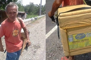 Old man born with disabled arm and foot walks everyday to sell ice drops for a living