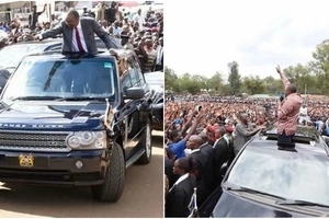 Uhuru lets school boy relax on his car roof (photos)