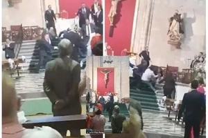 Confusion as man, 22, storms CHURCH wedding shouting 'Allah is great', attacks priest (photos)