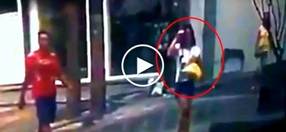 Dangerous Pinoy snatcher steals expensive phone from female pedestrian in EDSA