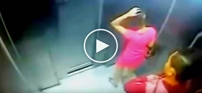 Terrifying CCTV footage! Hostile criminal violently mugs helpless woman inside elevator