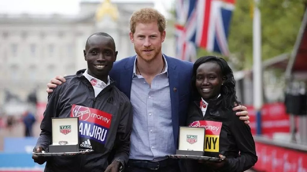 Wanjiru and Keitany pose with Britain's Prince Harry with their trophies