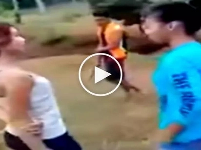 Furious Filipina teens get into vicious fight after school in front of their excited friends