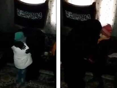 Heartbreaking! Jihadi Parents Hug and Kiss Their 7-year-old Daughter before Sending Her Off as a Bomber