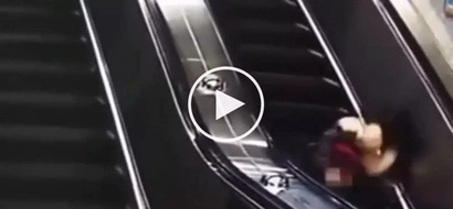 Careless woman in high heels violently tumbles down escalator after losing her balance