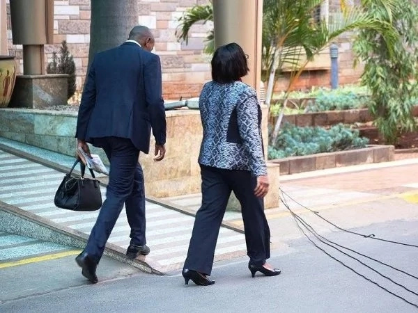 Photos of male bodyguards carrying the handbags of female Jubilee Cabinet Secretaries are cute to look at