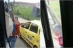 Defying death! Man hangs off the wing-mirror while bus speeds off