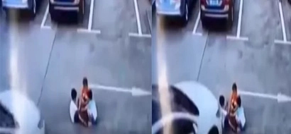 The car ran over kids playing at the parking lot. Distracted woman was using her smartphone while driving