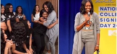 This picture of Michelle Obama with students shows what being an inspiration and role model looks like