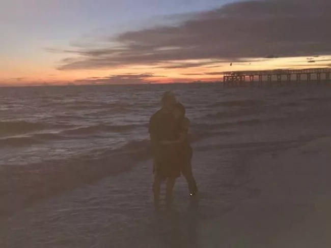 Creepy ghost appeared behind this young couple at the beach