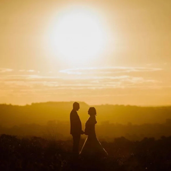 The photographer also shared another stunning photo of the couple silhouetted against the sunset