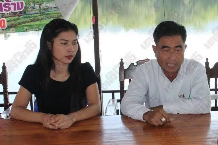 Tambon pictured with his latest wife, 27-year-old Nam Fon. Photo: Daily News