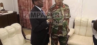 Mugabe seen for the first time after military coup holding talks with army chief at State House in Harare