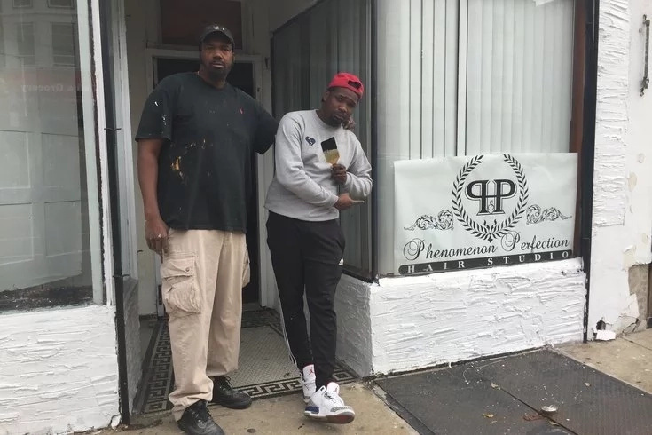 Jones pictured outside his new barbershop with Sean Johnson. Photo: PhillyVoice
