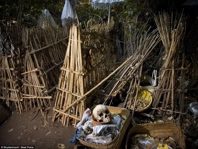 Burial not allowed! Village where dead members are dumped in bamboo cage and left to rot in bizarre ritual (photos)