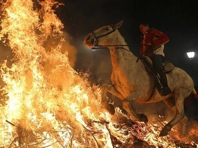Incredible and cruel! Horses forced to leap through FIRE at religion festival (photos)