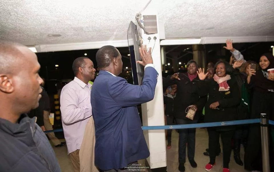 Raila bids bye to his supporters at JKIA as he flies out of the country (photos)