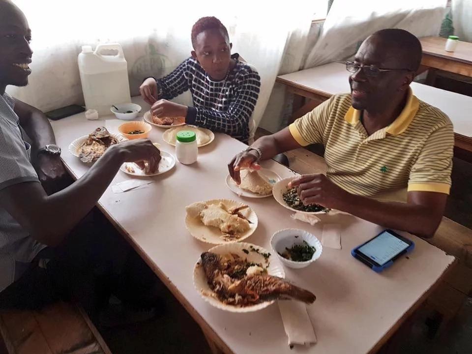 Former CJ Willy Mutunga eats fish and Ugali at a Kibanda