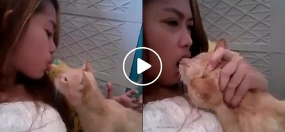 This Pinay was just giving a treat to her cat but she ended up being bitten right on the lips
