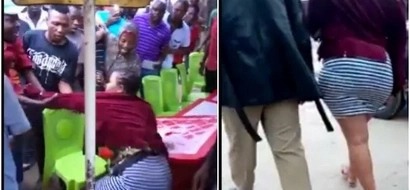 'Starved' crowd tries to undress curvy woman in public because of her short skirt(video)