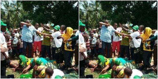 Women lie down as MP walks on their backs(photo)