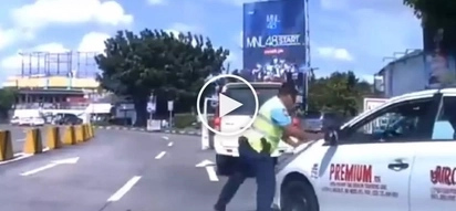 Road rage in Manila! Crazy Pinoy taxi driver tries to run over policeman