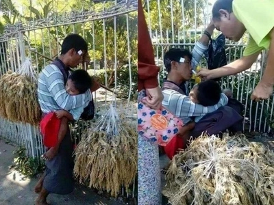 Nakakaawa! Man passes out while carrying his child and selling his wares on the street