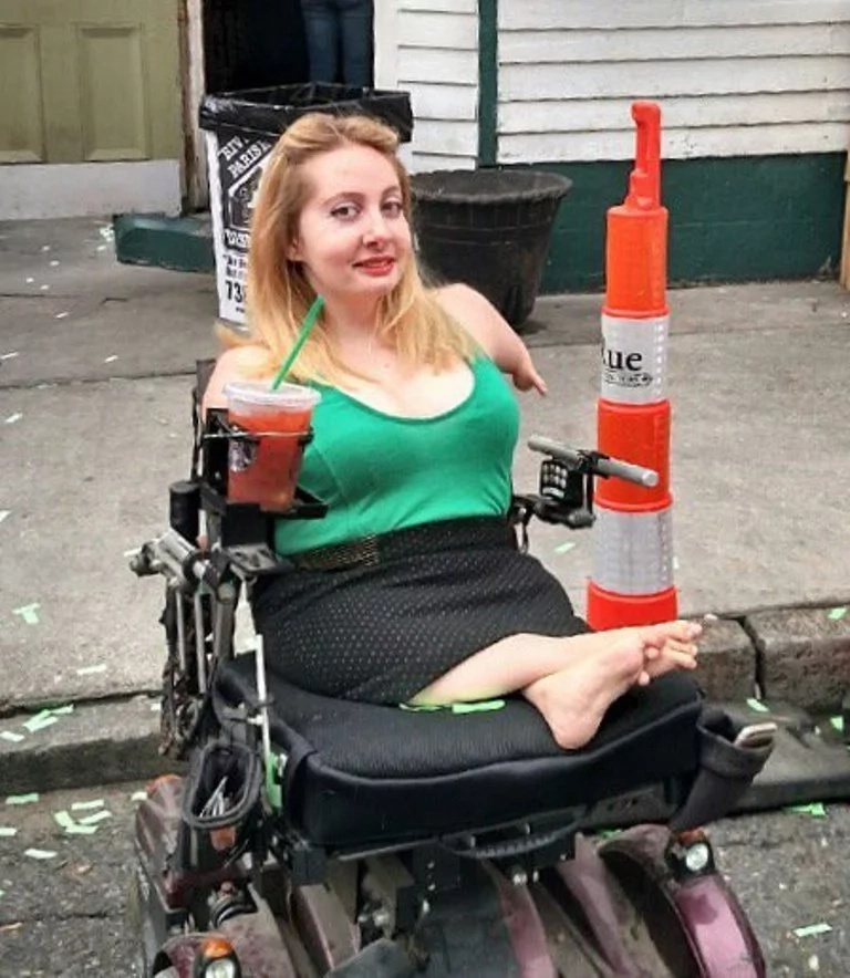 Disabled girl, 25, takes social media by storm after posting snapshots of her CUTE self (see photos)