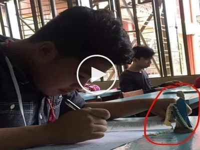 Netizens discuss the photo of Pinoy student who brought Virgin Mary statue to exams