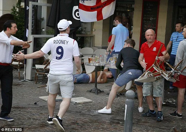 England fans throw coins for begging children to chase