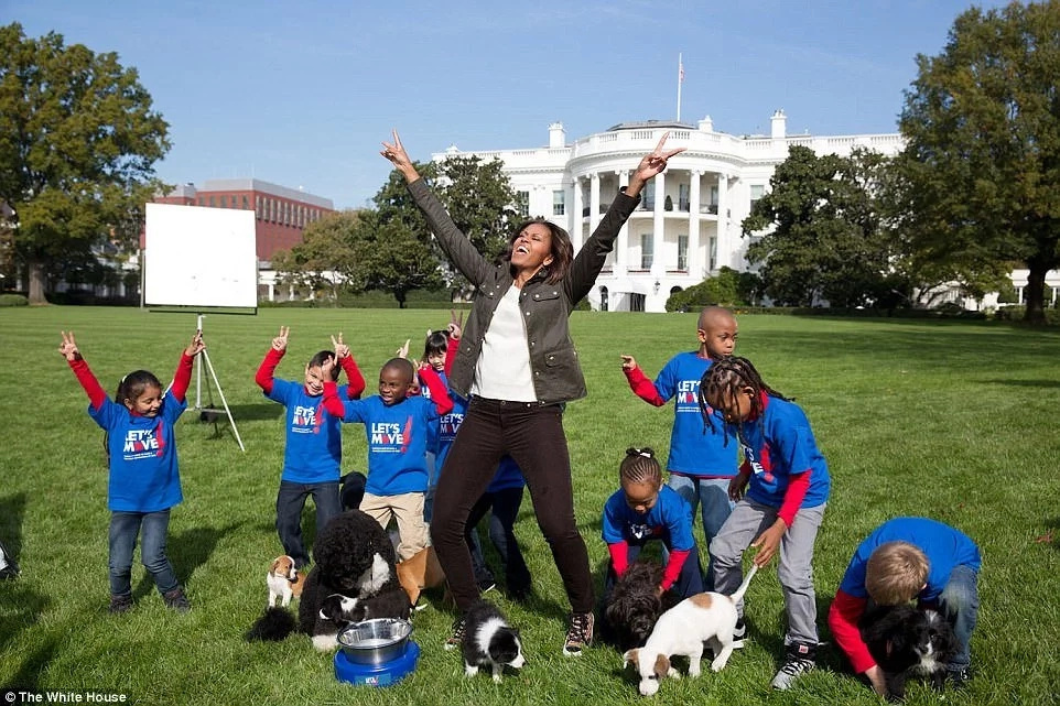 Obama pictured during a filming for the Animal Planet Puppy Bowl in 2013. Photo: The White House