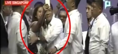 Hot Duterte gives woman in Singapore a tight embrace and she has now fallen head-over-heels
