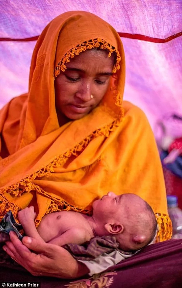 She had to flee just moments after giving birth to her son. Photo: Kathleen Prior