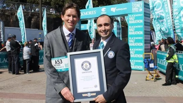 Whitaker receiving his Guinness World Record certificate. Photo: Daily Mail