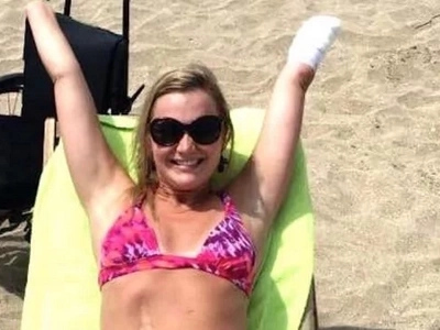 WATCH: Woman who lost limbs to flesh-eating bacteria finds a boyfriend and goes to the beach!