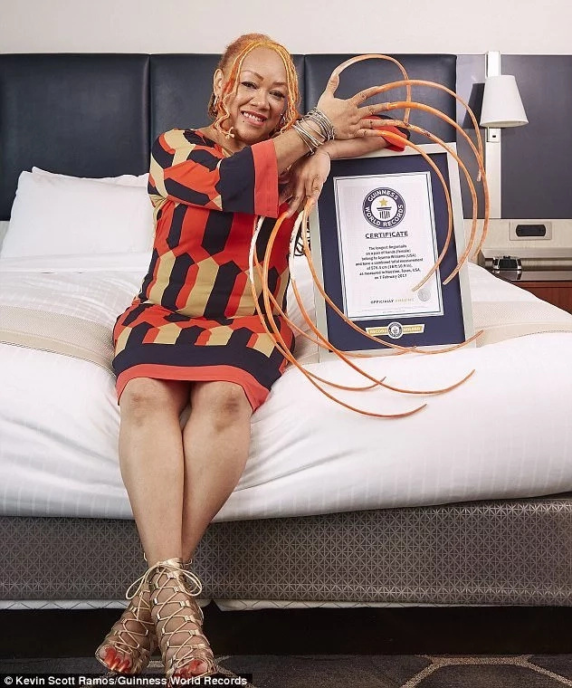 She shows off her Guinness World Records certificate. Photo: Guinness World Records