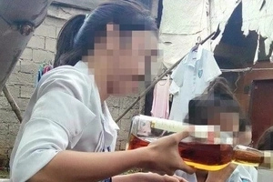 Young student's shocking photo drinking alcohol while still wearing school uniform gains mixed reactions from netizens