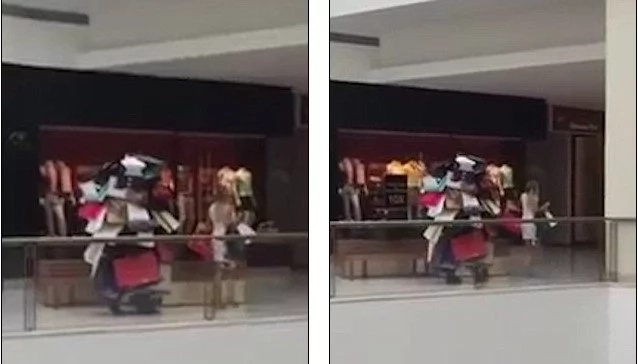 World's best husband: Man spotted carrying HUGE pile of wife's bags in shop (photos, video)