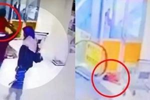 Una pequeña que iba en los hombros de su padre se cayó por el lado de unas escaleras hasta el piso de abajo