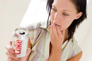 Diet Coke CAN actually make you fat. Here's why