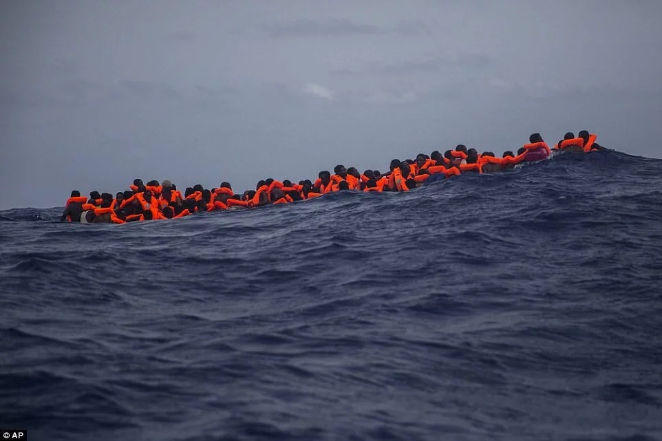 Some of the migrants awaiting rescue. Photo: AP