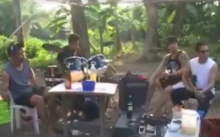 Band performs in the middle of a forest