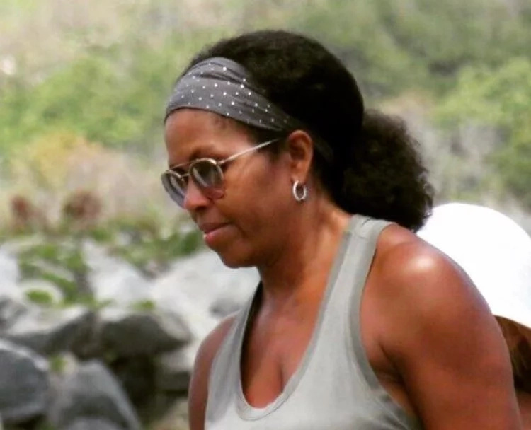 Internet explodes after RARE photos of Michelle Obama wearing her natural hair pop up (photos)