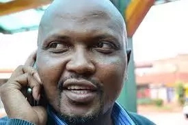Photos of Moses Kuria with Raila Odinga in mass action
