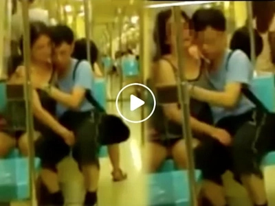 Indecent couple caught provocatively rubbing each other in train