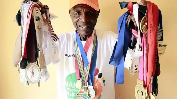 Raphulu shows off his medals. Photo: ANA