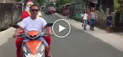 Pinoy Santa Claus suffers embarrassing accident while riding motorcycle during Christmas