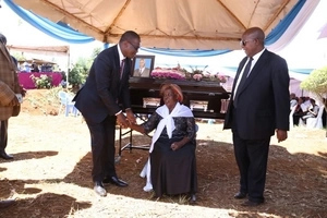 TEARS and SORROW as father of prominent Jubilee MP is buried